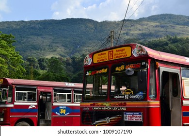 Sri Lanka - March, 2017: Red buses on a bus station on the background of mountains. Ashok Leyland Indian vehicle
