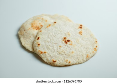 Sri Lankan Pol Roti on white background
