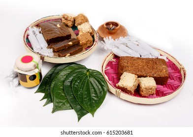 Sri Lankan Traditional Sweets and Foods on Table with Betel Leaves