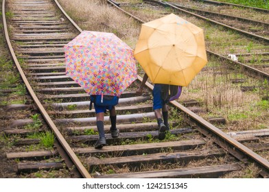 Sri Lankan young male students walks on the railway to come home after school in Ella city.
