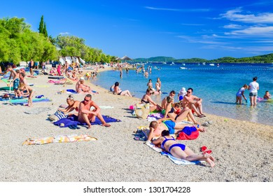 Srima, Croatia - July 08, 2018: Vacationers on the beach on a warm sunny day.