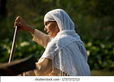 Srinagar, India, 2012: kashmir woman on a boat