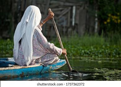 Srinagar, India, 2012: a woman on a boat