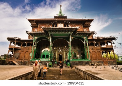 SRINAGAR, INDIA - APRIL 11: Muslim People at the uniquely wooden Shah E Hamdan mosque, a major Kashmir tourist attraction, for morning prayers on APRIL 11, 2012 in Srinagar, India