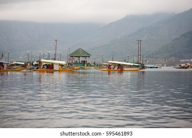 SRINAGAR, INDIA - APRIL 13: Dal Lake, The second largest in the state, Local people and traveler are use small wooden boat call 'Shikara' is a vehicle in the lake on Apr 13, 2014 in Srinagar, India