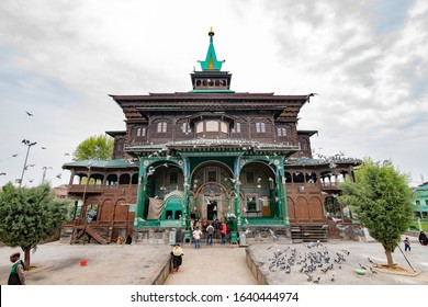 SRINAGAR, INDIA - APRIL 14, 2019: Muslim People at the uniquely wooden Shah E Hamdan mosque, a major Kashmir tourist attraction for morning prayers.