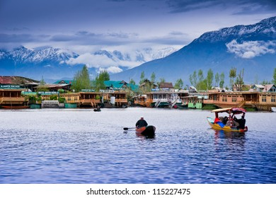 SRINAGAR, INDIA - April 15: Lifestyle in Dal lake,local people use 'Shikara', a small boat for transportation in the lake., April 15, 2012 in Srinagar, Kashmir, India