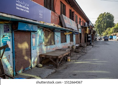 Srinagar / India - August 26 2019: A closed bank on a street in Kashmir on a late afternoon