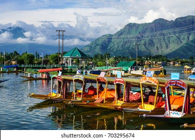 Srinagar, India - Jul 23, 2015. Traditional boats docking on Dal Lake in Srinagar, India. Srinagar, the summer capital of Jammu & Kashmir, is as beautiful as it is politically unstable.