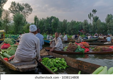 SRINAGAR, INDIA - JULAY 31, 2017: Indian vegetable traders in floating vegetable market in the middle of Dal Lake in Srinagar, Kashmir, India.