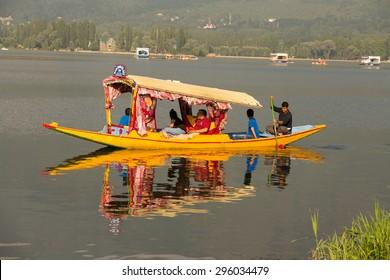 SRINAGAR, INDIA - JULY 02, 2015 : Lifestyle in Dal lake, local people use 'Shikara', a small boat for transportation in the lake of Srinagar, Jammu and Kashmir state, India
