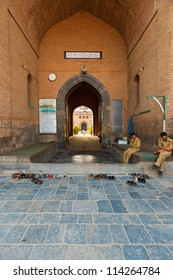 Srinagar, India - July 11, 2009: Guards sitting, securing the front entrance of the Main Mosque, Jama Masjid in Kashmir
