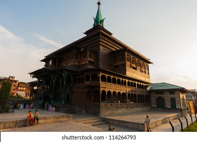 Srinagar, India - July 11, 2009: Local Muslim people gather after evening prayers outside of Shah E Hamdan, a unique wooden mosque in Kashmir