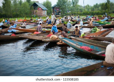 Srinagar, India - July 11, 2009: Kashmiri men buying and selling vegetables at the morning floating market on Dal Lake, major tourist attraction, in Kashmir