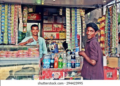 SRINAGAR, INDIA - JUNE 11, 2012 : Grocery owner selling drinking water and snacks in SRINAGAR, India.