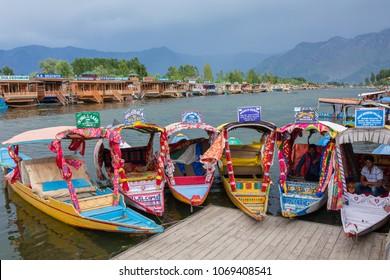 Srinagar, India - June 14, 2017: Colorful shikara boats in Dal lake, Jammu and Kashmir, India. Local people use Shikara for transportation in Dal lake between pier and boat house.