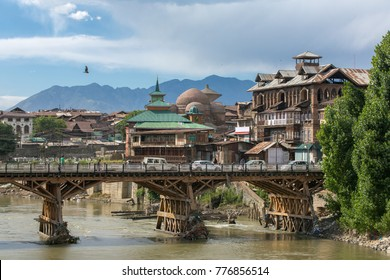 Srinagar, India - June 15, 2017: Riverside view of old town Srinagar from one of the bridges across Jhelum river, Jammu and Kashmir, India.