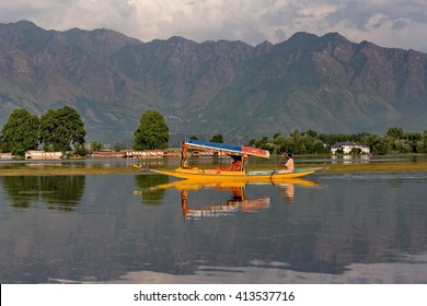SRINAGAR, INDIA - JUNE 29, 2014 : Lifestyle in Dal lake, local people use 'Shikara', a small boat for transportation in the lake of Srinagar, Jammu and Kashmir state, India