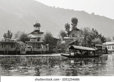 SRINAGAR, INDIA - October 2017: Dal lake in Srinagar city. Shikara boats on the water, everyday life on Dal lake, Srinagar, Jammu and Kashmir, India