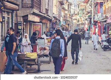 SRINAGAR, INDIA - October 2017: Market street with different shops and people walking in old town Srinagar, India