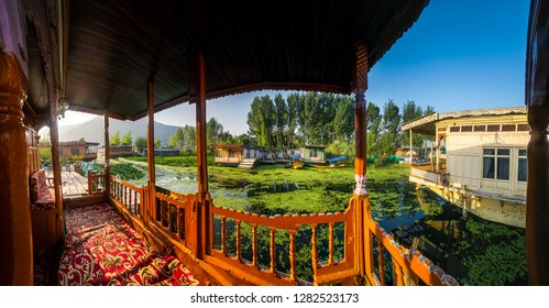 Srinagar, India - September 12, 2018: View from a  terrace on the river and houseboats typical for town of Srinagar in Kashmir, India. Illustrative editorial.