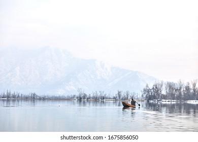 Srinagar, Jammu & Kashmir- 24th Jan 2020- A man sails his boat on Dal Lake