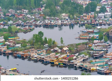 Srinagar, Jammu and Kashmir - April 15, 2019 : Aerial view cityscape of Houseboat in Dal Lake is famous place the main attractions at Srinagar, Jammu and Kashmir, India.