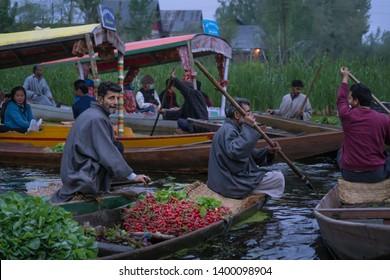 Srinagar, Jammu and Kashmir - April 16, 2019 : Kashmiri men Indian vegetable traders at floating market on Dal Lake daily early morning is major tourist attractions in Srinagar