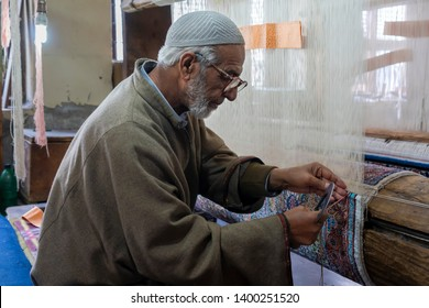 Srinagar, Jammu and Kashmir - April 18, 2019 : Traditional Kashmiri handmade persian carpets weaves making carpet is a native weaving craft of Kashmir skilled weavers highly quality