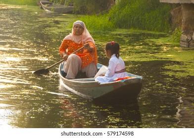 SRINAGAR, JAMMU KASHMIR, INDIA, 18 SEPTEMBER 2015 : Lifestyle in Dal lake, local people use Shikara a small boat for transportation in the lake of Srinagar.