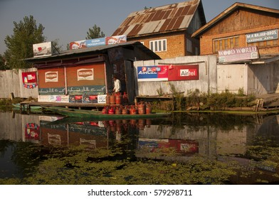 SRINAGAR, JAMMU KASHMIR, INDIA, 18 SEPTEMBER 2015 : Houses of Small village in Dal Lake, local people use small boat for transportation.