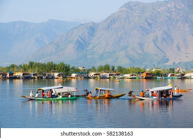 SRINAGAR, JAMMU KASHMIR, INDIA, 18 SEPTEMBER 2015 : Aerial view of Dal Lake, Houses of Small village and houseboat, local people use small boat for transportation.