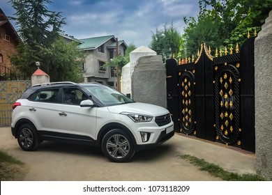 Srinagar, Jammu and Kashmir, India - April 19, 2018: A car about to enter a house through the gate which is closed