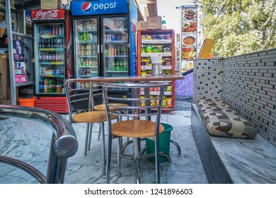 Srinagar, Jammu and Kashmir, India: Date- October 15, 2018- An open air cafe selling beverages and food with chairs provided for customers outside
