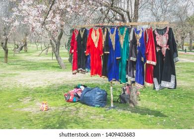 Srinagar, Jammu & Kashmir, India- Dated: May 22, 2019- Traditional multi coloured Kashmiri dresses on display at a stall in Badamwari Kashmir during the local almond festival