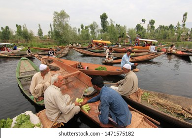 Srinagar, Jammu and Kashmir / India - June 23 2014: A view of the local vegetable market on shikaras at the Dal lake in Srinagar