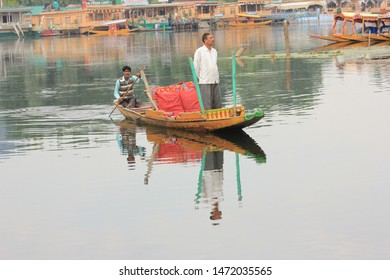 Srinagar, Jammu and Kashmir / India - June 23 2014: A beautiful view of the Dal Lake in Srinagar with a traditional boat known as shikara floating on it!