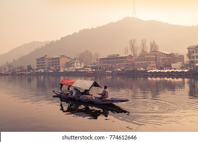 Srinagar, Jammu and Kashmir, India - November 19, 2015 : A Shikara Boat Floating On Dal Lake Lake in Srinagar, Kashmir, Jammu and Kashmir State, India