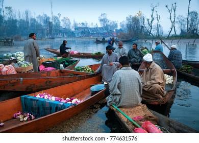 Srinagar, Jammu and Kashmir, India - November 19, 2015 : Sellers gathered to sell their vegetables in floating market at Dal Lake, Srinagar