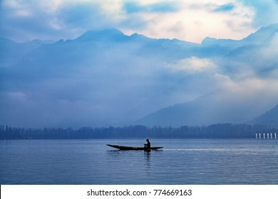 Srinagar, Jammu and Kashmir, India - November 16, 2015 : A picturesque Dal lake with mountains in background in Srinagar, Jammu and Kashmir, India