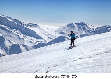 Srinagar, Jammu and Kashmir, India - November 17, 2015 : A woman skiing downhill on snow covered Himalayan Mountain in Gulmarg, Jammu and Kashmir, India