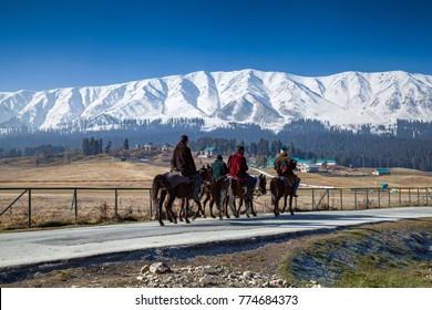 Srinagar, Jammu and Kashmir, India - November 17, 2015 : Tourists enjoying horse ride at Gulmarg, Jammu and Kashmir, India