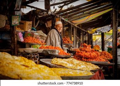 Srinagar, Jammu and Kashmir, India - November 15, 2015 : An old Kashmiri man at his sweet shop in Srinagar, Jammu and Kashmir, India