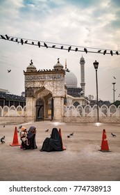 Srinagar, Jammu and Kashmir, India - November 15, 2015 : Two Muslim ladies sitting outside Hazratbal Dargah(Shrine) in Srinagar, Jammu and Kashmir, India