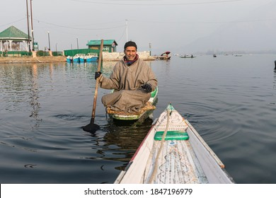 Srinagar, January 03, 2018: A local Kashmiri boatman  on his shikara on the famous Dal lake in Srinagar
