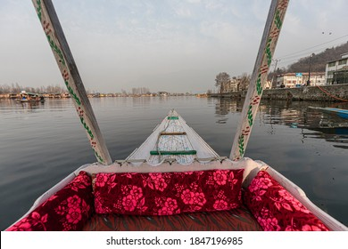 Srinagar, January 03, 2018: A view from inside a shikara  with blurred view of the surrounding water and building around the Dal lake.