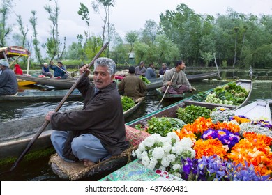 SRINAGAR KASHMIR - CIRCA APRIL 2016 - Unidentified vegetable and flower sellers taking their produce to the Dal Lake early morning floating market.
