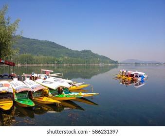 Srinagar, Kashmir, India - Circa June 2014 - Small boats also known as 'Shikara' used as a transportation means in Dal Lake. Srinagar, Kashmir