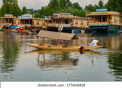 Srinagar, Kashmir, India - July 20, 2015: Kashmiri local man transporting in their boat called Shikara. Which are also the local means of transport.