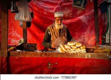 Srinagar, Kashmir, India - November 15, 2015 : An old Kashmiri man at his bakery stall in Srinagar, Jammu and Kashmir, India